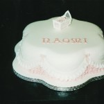 Petal Shape Christening Cake With A Cradle