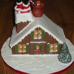Handmade festive christmas cakes in poole dorset Santa stuck in chimney cake