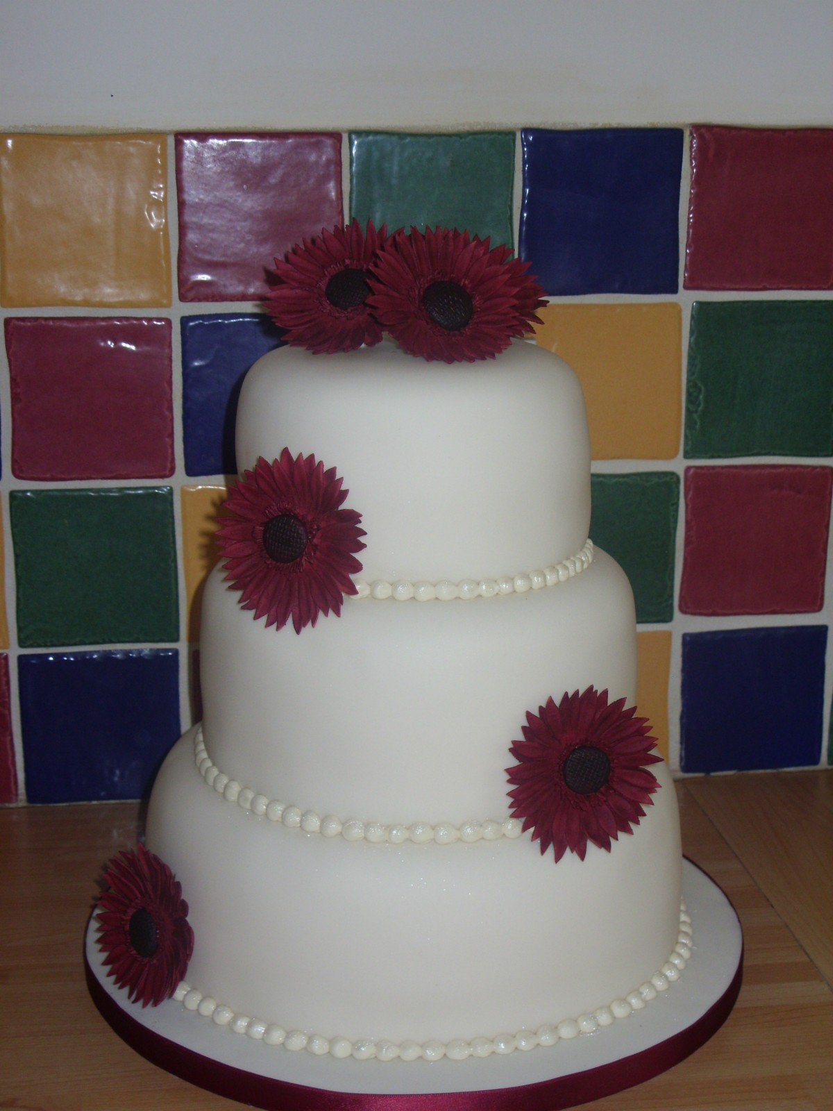 how to stack a 3 tier fruit wedding cake 3 tier stacked wedding cake with gerberas 171 susie s cakes 16146