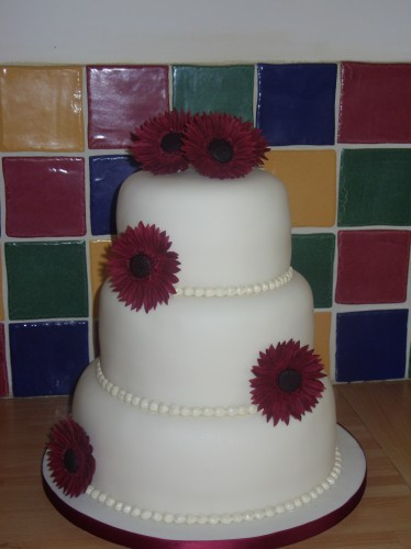3 Tier Stacked Wedding Cake With Gerberas