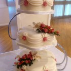 3 tier petal traditional style wedding cake with sugar flowers roses and orchids