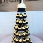 wedding cupcake tower with giant cupcake bride and groom topper