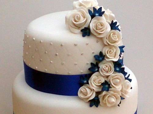 3 tier round stacked wedding cake sapphire blue and white sugar flowers