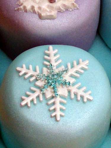 box of mini sparkling novelty christmas cakes