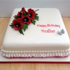 square birthday cake with a sparkling spray of sugar poppies