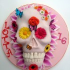 vibrant novelty skull cake with flowers and butterflies