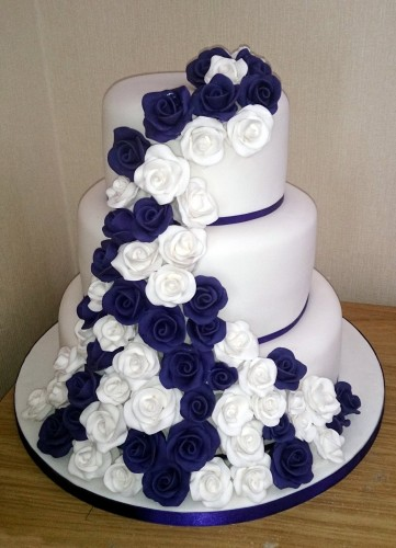 3 tier white and purple rose wedding cake