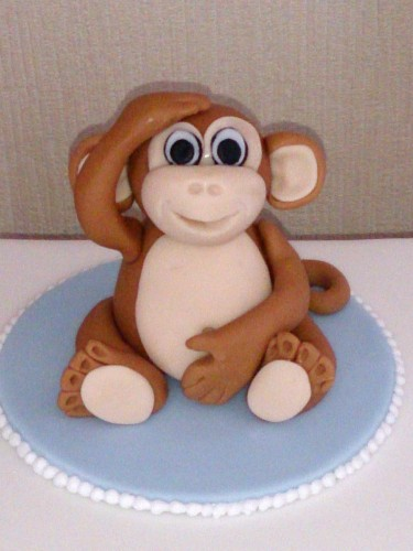 Cheeky monkey christening cake
