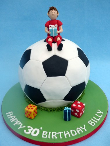 footballer sat on a football birthday cake