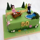 joint 50th birthday cake with a garden fishing and crafting theme