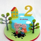 peppa pig and family themed birthday cake