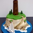sailing around the lighthouse birthday cake