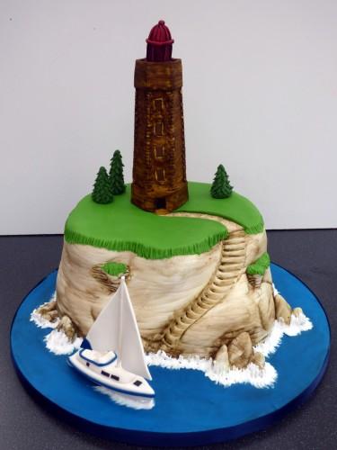 sailing around the lighthouse birthday cake