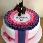 show jumping pony with rosette themed birthday cake