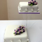 2 tier classic floral wedding cake with sugar flower spray