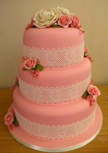 3 tier wedding cake with lace peonies and roses