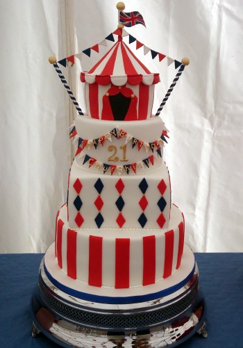 4 tier circus themed cake with big top sponge pole dorset