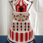 4 tier circus themed cake with big top