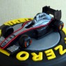F1 pirelli tyre themed 3 tier wedding cake with bride and groom and F1Mclaren racing car thumbnail