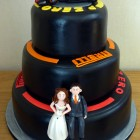 F1 pirelli tyre themed 3 tier wedding cake with bride and groom and F1Mclaren racing car