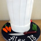 chefs hat birthday cake with fondant vegetables knife birthday cake