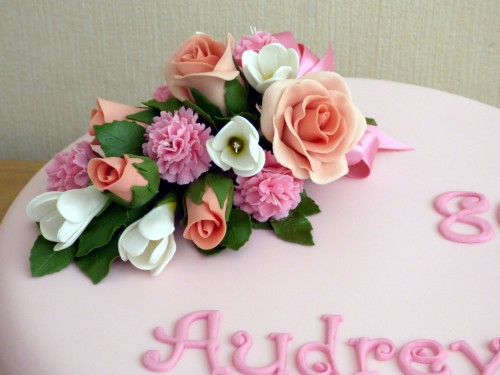 classic floral birthday cake with sugar flower spray