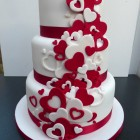 red and white heart themed 3 tier wedding cake