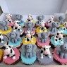 twins 11th birthday cake with cow and elephants and cupcakes thumbnail