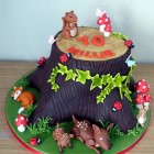woodland themed birthday cake tree stump squirrel fox rabbit deer toadstool