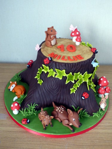woodland themed birthday cake tree stump squirrel fox rabbit deer toadstool