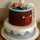 Santa and rudolph in a hot tub novelty christmas cake