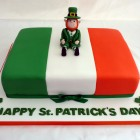 st patrick's day celebration cake with leprechaun topper