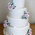 4-tier-ivory-wedding-cake-with-lego-figures-and-roses