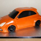 electric-orange-vauxhall-corsa-car-birthday-cake
