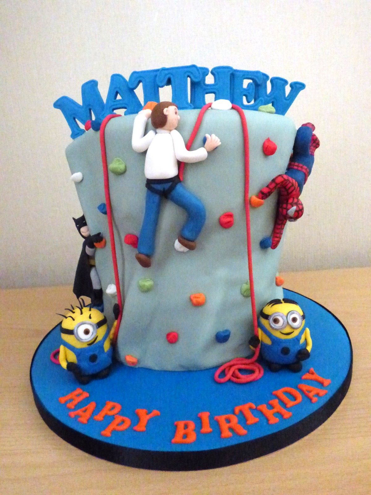 Climbing Wall Cake With Batman Spiderman And Minions Susies Cakes