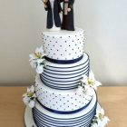 4-tier-wedding-cake-with-personalised-harry-potter-jedi-toppers