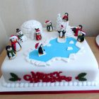 penguins-having-fun-christmas-cake