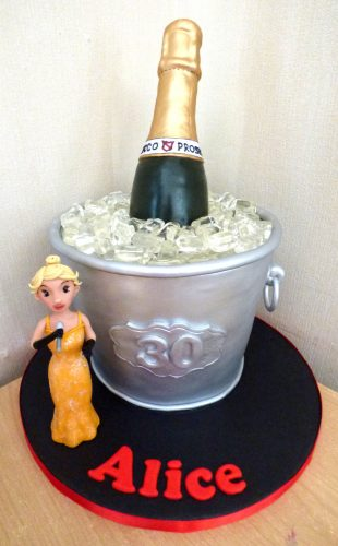 prosecco-in-ice-bucket-cake-with-singer-birthday-cake