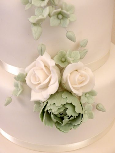 3-tier-white-and-sage-green-wedding-cake-sugar-flowers