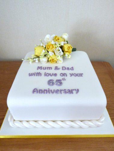 65th-wedding-anniversary-cake-with-sugar-flowers-tulips-freesia