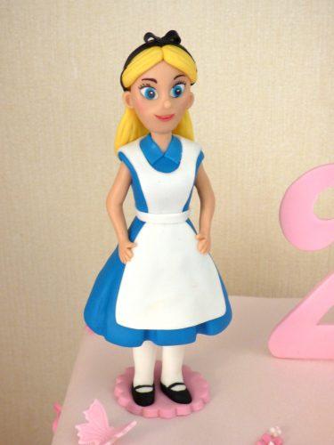 2-tier-alice-in-wonderland-multi-themed-birthday-cake-fondant-iggle-piggle-upsey-daisy-mr-tumble-tweenies-fizz-milo-dorset-detail-1